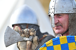 © Licensed to London News Pictures. 13/10/2018<br /> BATTLE, UK.<br /> Saxon warriors before battle.<br /> English Heritage Battle of Hastings re-enactment at Battle Abbey,Battle, on the 1066 battle field.<br /> Photo credit: Grant Falvey/LNP