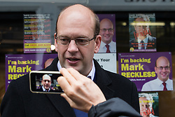 © Licensed to London News Pictures . 17/11/2014 . Kent , UK . UKIP candidate MARK RECKLESS being videoed on a mobile phone outside the UKIP shop on High Street Rochester , ahead of the Rochester and Strood by-election . Photo credit : Joel Goodman/LNP