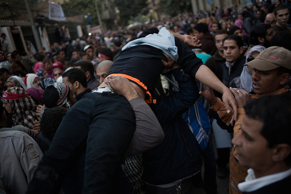 EGYPT, Cairo :Thousands of demonstrators protest outside the parliamentary headquarters to press for an end to military rule. Small clashes occurred as some Muslim Brotherhood supporters tried to prevent anti-SCAF protesters (specially women)  from reaching the building of Parliament. .