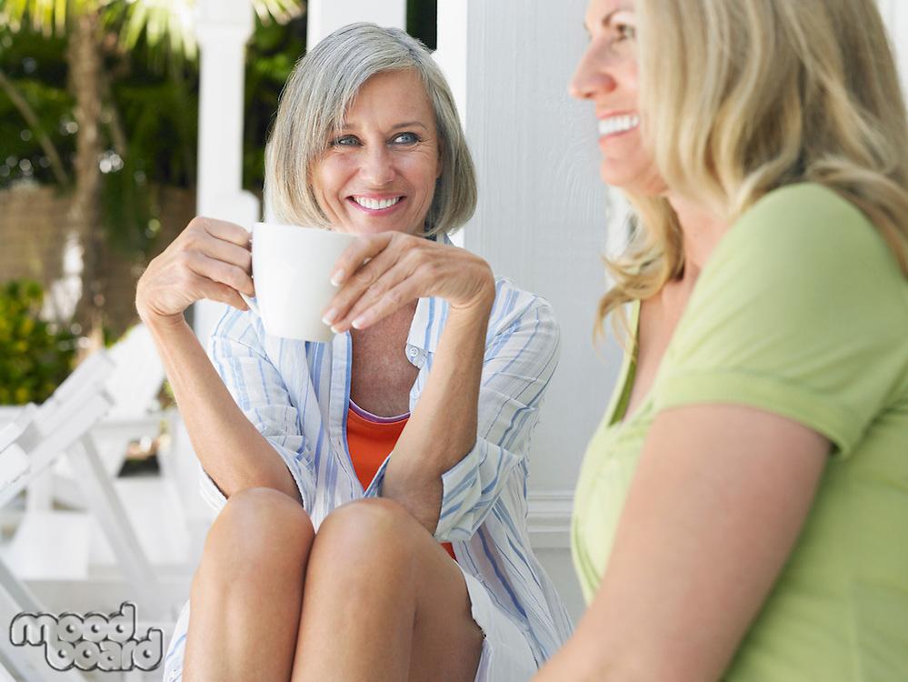 Two women sitting on verandah