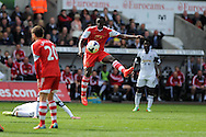Southampton's Victor Wanyama &copy; has a shot blocked. Barclays Premier league match, Swansea city v Southampton at the Liberty stadium in Swansea, South Wales on Saturday 3rd May 2014.<br /> pic by Andrew Orchard, Andrew Orchard sports photography.