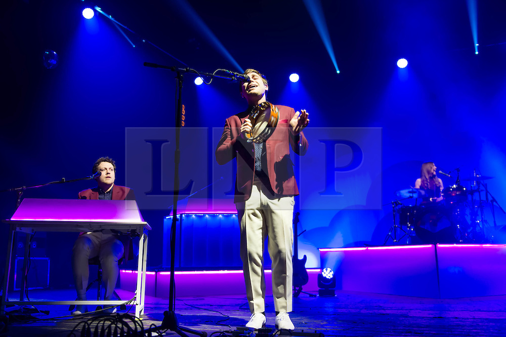 © Licensed to London News Pictures. 28/03/2014. London, UK.   Metronomy performing live at Brixton Academy to promote their latest album Love Letters. In this picture - Joseph Mount. (left), Oscar Cash (centre), Anna Prior (right).  Metronomy are an english electronic music group consisting of members Joseph Mount (vocals, Guitar, keyboard),<br /> Oscar Cash (keyboards/sax), Anna Prior (bass), Olugbenga Adelekan (drums).   Photo credit : Richard Isaac/LNP