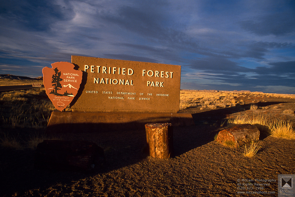 Entrance sign to Petrified Forest National Park at sunset. ..Subject photograph(s) are copyright Edward McCain. All rights are reserved except those specifically granted by Edward McCain in writing prior to publication...McCain Photography.211 S 4th Avenue.Tucson, AZ 85701-2103.(520) 623-1998.mobile: (520) 990-0999.fax: (520) 623-1190.http://www.mccainphoto.com.edward@mccainphoto.com..