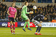 Millwall defender Jake Cooper (5) ducks as Millwall goalkeeper David Martin (16) catches the ball during the EFL Sky Bet Championship match between Millwall and Queens Park Rangers at The Den, London, England on 10 April 2019.