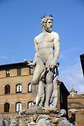 Neptune, Roman gold of the Sea (Greek Poseidon). White marble sculpture on top of the fountain by Bartolomeo Ammanati (1511-1592)  in the Piazza della Signoria, Florence, Italy.  Male Nude