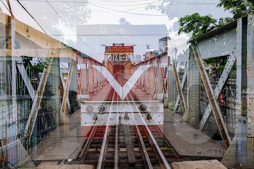 Multiple exposure of a train and Long Bien Bridge in perspective, Hanoi, Vietnam, Southeast Asia