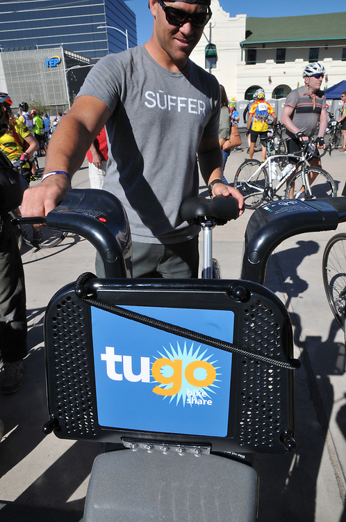 After taking a Tugo bike for a spin, a rider returns it to the locking dock.