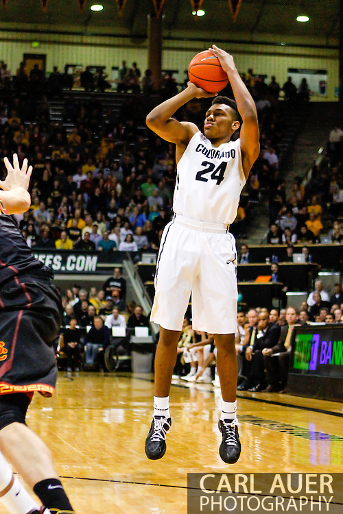 January 18th, 2014:  Colorado Buffaloes freshman guard/forward George King (24) attempts a three point shot in the first half of action in the NCAA Basketball game between the USC Trojans and the University of Colorado Buffaloes at the Coors Events Center in Boulder, Colorado