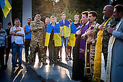 Members of the clergy, military men and Ukrainian patriots wearing the nation's flag are attending a ceremony to commemorate recently killed soldiers during the Donbas war, in Mariupol, southeast Ukraine.
