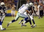 Dallas Cowboys quarterback Jameill Showers (7) tackles an opponent during the 2015 NFL preseason football game against the San Diego Chargers on Thursday, Aug. 13, 2015 in San Diego. The Chargers won the game 17-7. (©Paul Anthony Spinelli)