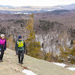 A couple hiking on the ledges of Huckleberry Mountain in South Johnsburg, New York. Adirondack Mountains.