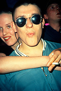 A clubber with sunglasses, gurning on the dancefloor of the Hacienda, Manchester 1988
