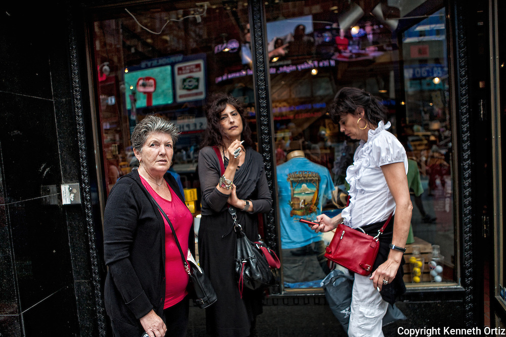 Three women in front of the Hard Rock Cafe store in Time Square in New York City.