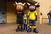 An Oxford United fans stand to have his photo with the Oxford mascots during the EFL Sky Bet League 1 match between Oxford United and Plymouth Argyle at the Kassam Stadium, Oxford, England on 17 February 2018. Picture by Jason Brown.