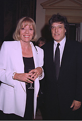 DAME DIANA RIGG and SIR TOM STOPPARD at a reception in London on 11th September 1997.MBC 79