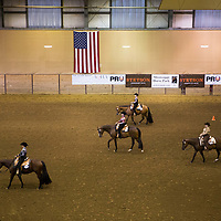 Lauren Wood | Buy at photos.djournal.com<br /> Competitors in the Horsemanship category walk their final loop in front of the judges before results are tallied on Friday, March 10 during the annual MSU Bulldog Classic AQHA Horse Show at the MS Horse Park in Starkville.