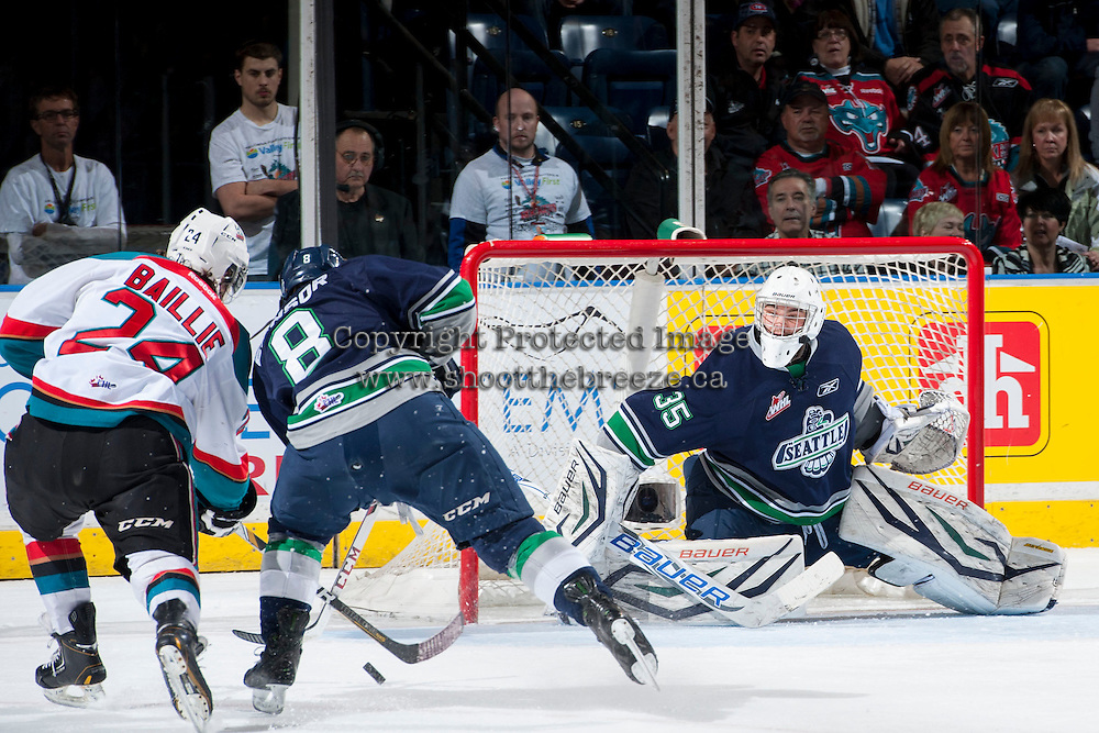 KELOWNA, CANADA - APRIL 5: Tyson Baillie #24 of the Kelowna Rockets takes a shot on Taran Kozun #35 as Scott Eansor #8 of the Seattle Thunderbirds attempts to block on April 5, 2014 during Game 2 of the second round of WHL Playoffs at Prospera Place in Kelowna, British Columbia, Canada.   (Photo by Marissa Baecker/Getty Images)  *** Local Caption *** Tyson Baillie; Scott Eansor; Taran Kozun;