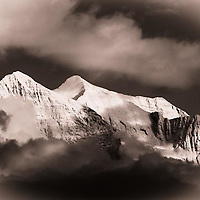 clearing stormy skys snow  capped mountains clouds