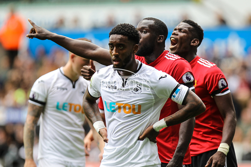 Leroy Fer of Swansea City is marked by Romelu Lukaku and Paul Pogba of Manchester United during the Premier League match between Swansea City and Manchester United at the Liberty Stadium, Swansea, Wales on 19 August 2017. Photo by Andrew Lewis.