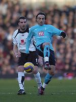 Photo: Olly Greenwood.<br />Fulham v Tottenham Hotspur. The Barclays Premiership. 20/01/2007. Tottenham's Dimitar Berbatov and Fulham's Ian Pearce