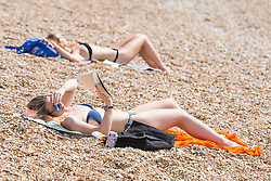 © Licensed to London News Pictures. 26/08/2017. Brighton, UK. Members of the public take to the beach in Brighton and Hove on the Bank holiday weekend Saturday. Photo credit: Hugo Michiels/LNP