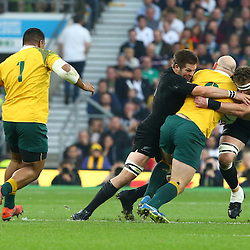 LONDON, ENGLAND - OCTOBER 31: Richie McCaw (captain) of New Zealand and Kieran Read of New Zealand tackle Stephen Moore (capt) of Australia during the Rugby World Cup Final match between New Zealand vs Australia Final, Twickenham, London on October 31, 2015 in London, England. (Photo by Steve Haag)