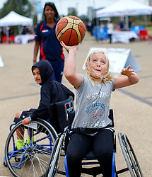 © Licensed to London News Pictures. 03/09/2016. LONDON, UK. Nicola Ryan plays paralympics basketball with a wheelchair to experience the disability sports at National Paralympic Day and Liberty Festival in Queen Elizabeth Olympic Park in London on Saturday 3 Spetember 2016. Photo credit : Tolga Akmen/LNP