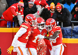 Jan 19, 2020; Kansas City, Missouri, USA;  Kansas City Chiefs wide receiver Sammy Watkins (14) celebrates with wide receiver Demarcus Robinson (11) and wide receiver Tyreek Hill (10) after scoring during the AFC Championship Game against the Tennessee Titans at Arrowhead Stadium. Mandatory Credit: Denny Medley-USA TODAY Sports