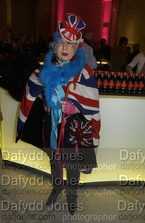 "Anna Piaggi . The private views for Anna Piaggi's exhibition ""Fashion-ology"" and also 'Popaganda: the life and style of JC de Castelbajacat' the Victoria & Albert Museum on January 31  2006. © Copyright Photograph by Dafydd Jones 66 Stockwell Park Rd. London SW9 0DA Tel 020 7733 0108 www.dafjones.com"