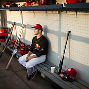 The Vancouver Canadians outfielder Chris Carlson sits in the dugout after a loss to the Hillsboro Hops in game one of the North West League championships.  Hillsboro went on to win the championships in the next game.