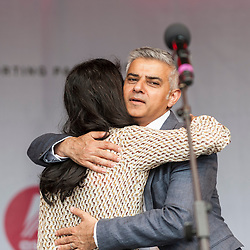 © Licensed to London News Pictures. 09/07/2016. London, UK. London's first Muslim Mayor of London,  Sadiq Khan, hugs BBC TV presenter, Konnie Huq, on stage at the EID festival in Trafalgar Square. Photo credit : Stephen Chung/LNP