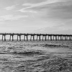 Pensacola Beach Florida Gulf Pier at sunrise ultra high resolution black and white panorama photo. Pensacola Beach Florida is in the Emerald Coast of the Florida Panhandle in the Updated States of America. Panoramic photo ratio is 1:5. Copyright ⓒ 2018 Paul Velgos with All Rights Reserved.