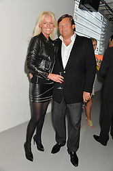 GARY & SHARON PASK at the Audemars Piguet Royal Oak Offshore 42mm Party held at Victoria House, Bloomsbury Square, London on 23rd April 2014.