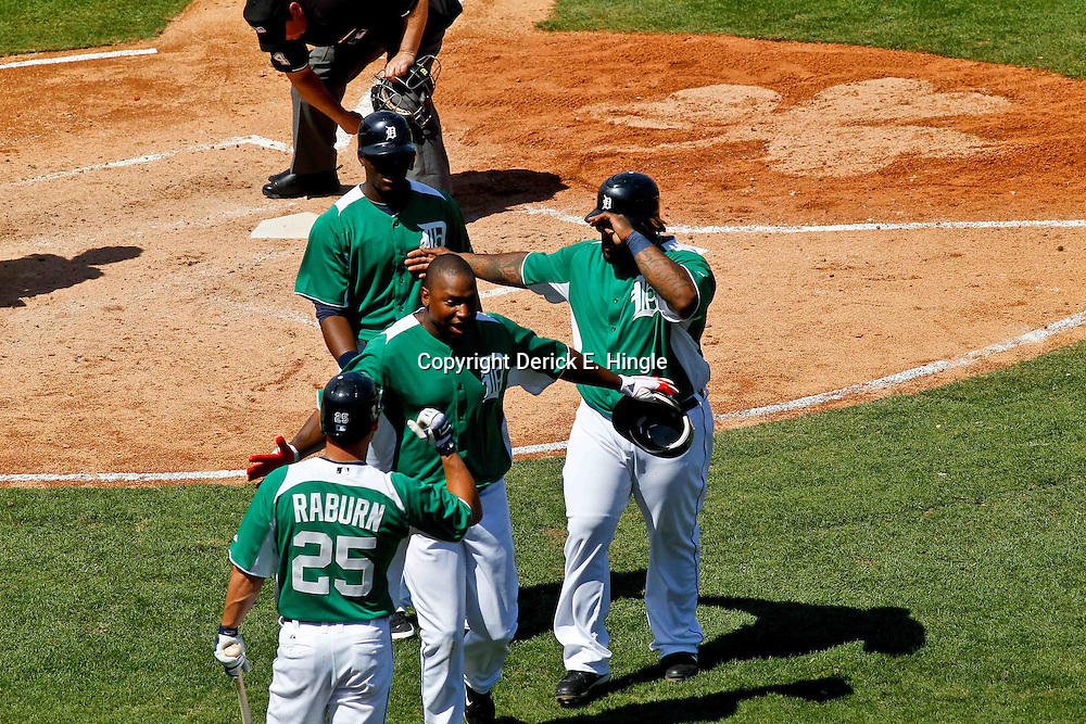 March 17, 2012; Lakeland, FL, USA; Detroit Tigers left fielder Delmon Young (21) hits a three run homerun scoring Audy Ciriaco and Prince Fielder during the bottom of the fifth inning of a spring training game against the St. Louis Cardinals at Joker Marchant Stadium. Both teams wore green jerseys and the field was marked with shamrocks for the St. Patrick's Day game. Mandatory Credit: Derick E. Hingle-US PRESSWIRE