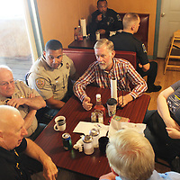 Sonny Clay, center, talks with members of the Monroe County Sheriff's Office during April 19's Coffee with a Cop at the Burger Shack in Aberdeen. It pulled together citizens with deputies and Aberdeen police officers for casual conversations and relationship building. Last week's event was the third Coffee with a Cop Aberdeen has had this year.