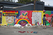 A passerby stops to read tributes left at a makeshift memorial around the Pulse Nightclub December 18, 2016 in Orlando, Florida. On June 12, 2016 49 people were killed and 53 injured in the deadliest mass shooting by a single gunman in U.S. history, and the deadliest terrorist attack on U.S. soil since the events of September 11, 2001.