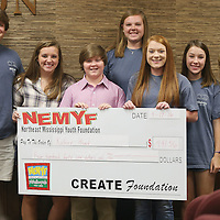Lauren Wood | Buy at photos.djournal.com<br /> Bryson Burkes, center, accepts a check on behalf of Kidney Head Foundation from the Northeast Mississippi Youth Foundation Sunday afternoon during their board meeting at the Create Foundation.
