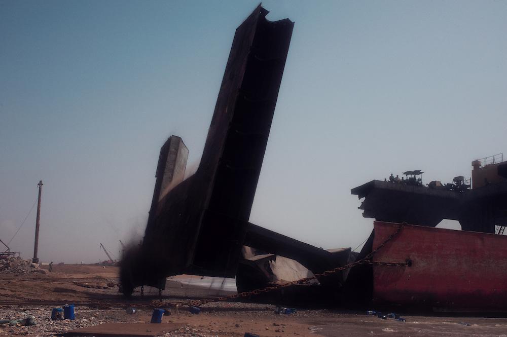 Men undertake demolition work at the Gadani ship breaking yard, Balochistan Province, Pakistan on August 16, 2011.