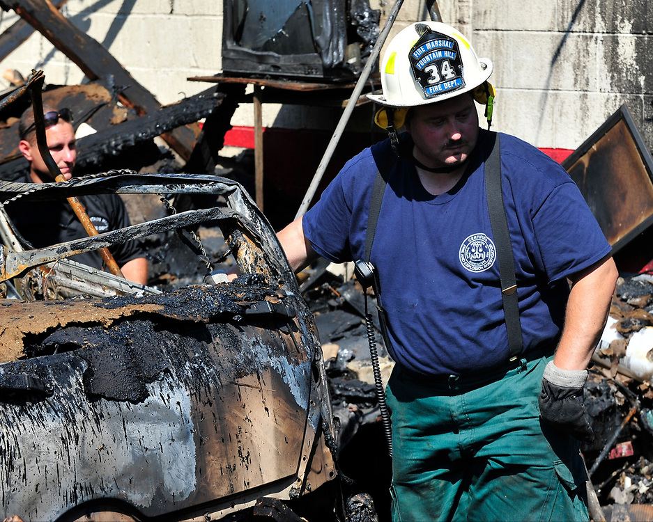 Fire investigators sift through the debris at the scene of a multiple-alarm fire that began Saturday evening at a commercial complex in the 500 block of South Benner Avenue on Sunday, July 16, 2017 in Fountain Hill. (Chris Post | lehighvalleylive.com contributor)