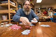 Kyle Engen, Co-Owner of IMOGAP, is usually up for playing a game when you visit the museum. Here he plays Trailer Park Wars.