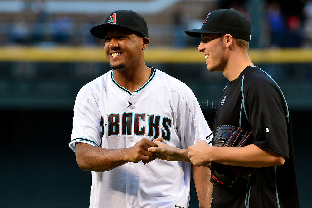 PHOENIX, AZ - APRIL 26:  Arizona Cardinals wide receiver Michael Floyd (L) shakes hands with Patrick Corbin #46 of the Arizona Diamondbacks after throwing out the ceremonial first pitch prior to the MLB game between the St. Louis Cardinals and Arizona Diamondbacks at Chase Field on April 26, 2016 in Phoenix, Arizona.  (Photo by Jennifer Stewart/Getty Images)