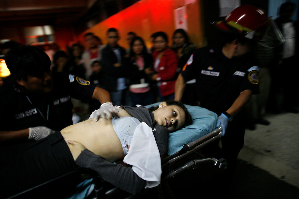 A women wounded during a shooting is carried on a stretcher to the emergency room of the San Juan de Dios hospital, Guatemala City, Thursday, Nov. 25, 2010. (AP Photo/Rodrigo Abd)
