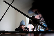 NEW YORK, NY - MARCH 25: Composer, songwriter and performer Gabriel Kahane with his cat Roscoe at his home in Brooklyn, NY on March 25, 2013. <br /> Kahane is a 31-year-old composer of the 'indie-classical' genre who has two performances coming up in Washington D.C., one sponsored by the Library of Congress in which he appears in recital with another composer/performer, and one with the Orpheus Chamber Orchestra; he's their first composer in residence and has written a new work that's a portrait of the USA based on WPA travel guides from the 1930s. Last year his musical FEBRUARY HOUSE got rave reviews for its run at the Public Theater in NY. (Photo by Melanie Burford/Prime For The Washington Post.)
