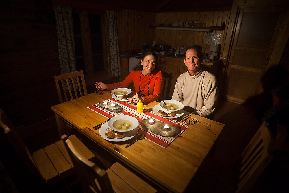 Liana and Parmenter Welty sit down for dinner in a rented traditional rorbu cabin in Å, Lofoten Islands, Norway.
