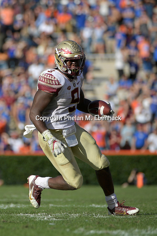 Florida State running back Jacques Patrick (9) rushes for yardage during the second half of an NCAA college football game against Florida Saturday, Nov. 25, 2017, in Gainesville, Fla. FSU won 38-22. (Photo by Phelan M. Ebenhack)
