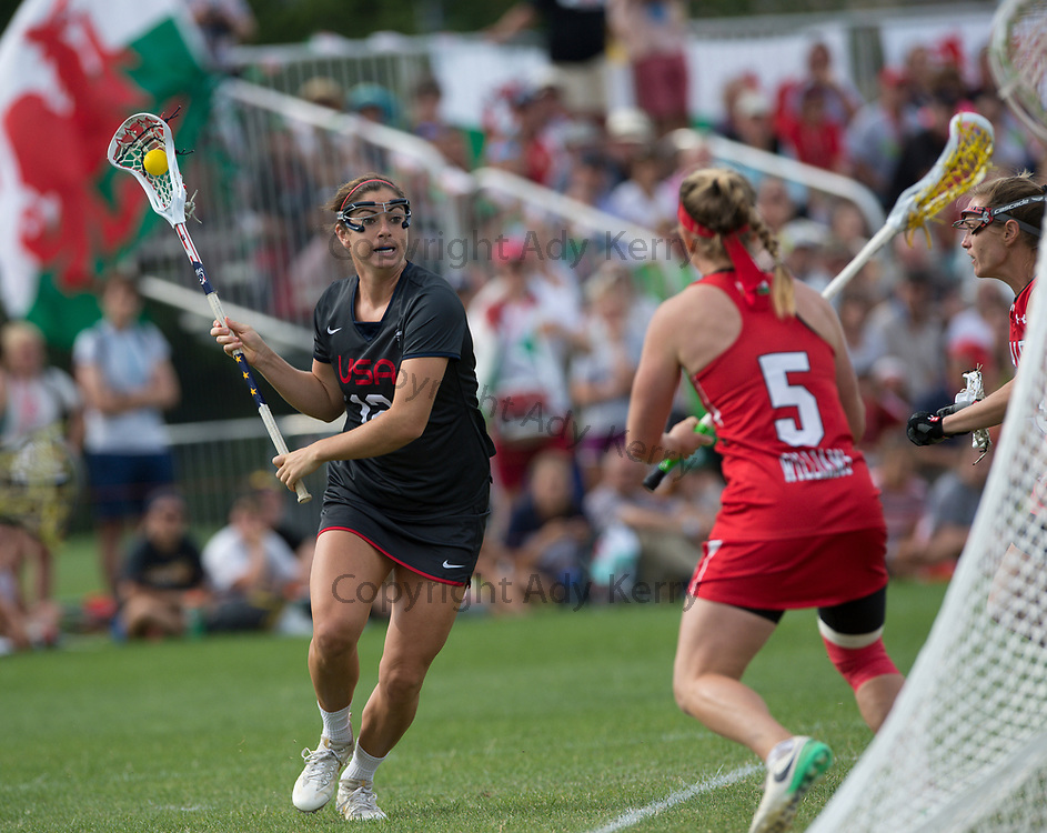USA's Kayla Treanor  challenges with Wales' Charlotte Williams at the 2017 FIL Rathbones Women's Lacrosse World Cup, at Surrey Sports Park, Guildford, Surrey, UK, 18th July 2017.