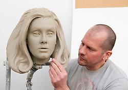 Sculptor Louis Wiltshire works on the clay head that will be used to create the wax mould for superstar songstress Adele's new wax figure at Madame Tussauds attractions in London and Amsterdam. Work is now well underway on the Oscar Winner's figure which will be portrayed in dramatic performance pose. Adele, who turns 25 this weekend, will join the A-list line ups in London and Amsterdam in July,  London, UK, on 02 May 2013, 03 May 2013. Photo by:  i-Images