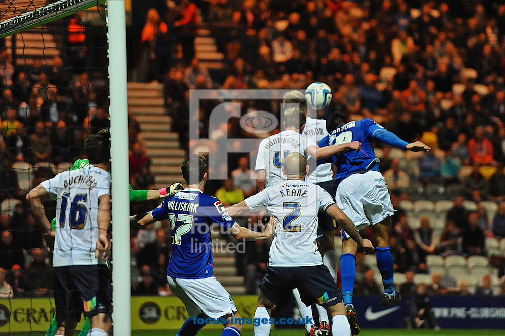 Picture by Ian Wadkins/Focus Images Ltd +44 7877 568959<br /> 09/09/2013<br /> Paul Huntington of Preston North End heads clear from Matteo Lanzoni of Oldham Athletic during the Sky Bet League 1 match at Deepdale, Preston.
