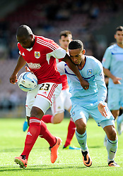 Bristol City's Marlon Harewood holds the ball up from Coventry City's Jordan Clarke  - Photo mandatory by-line: Dougie Allward/JMP - Tel: Mobile: 07966 386802 11/08/2013 - SPORT - FOOTBALL - Sixfields Stadium - Sixfields Stadium -  Coventry V Bristol City - Sky Bet League One