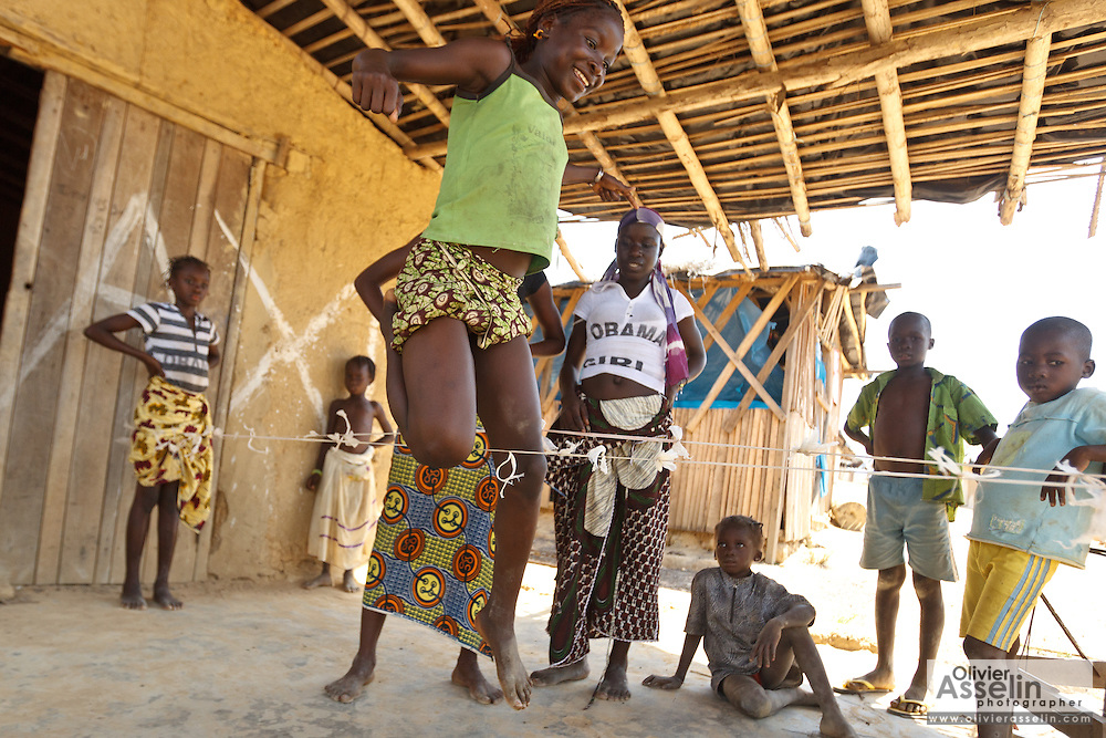 Girls play a game involving jumping strings while singing in the village of Popoko, Bas-Sassandra region, Cote d'Ivoire on Tuesday March 6, 2012.